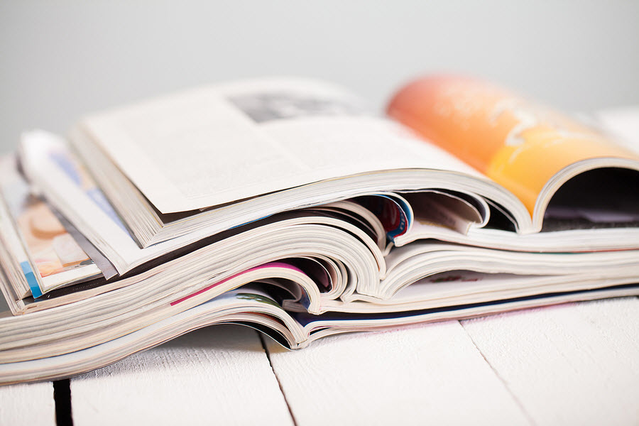 bigstock-Pile-of-colorful-magazines-on--45821608